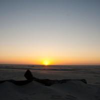 Zonsondergang bij Paal 8 / Strand West